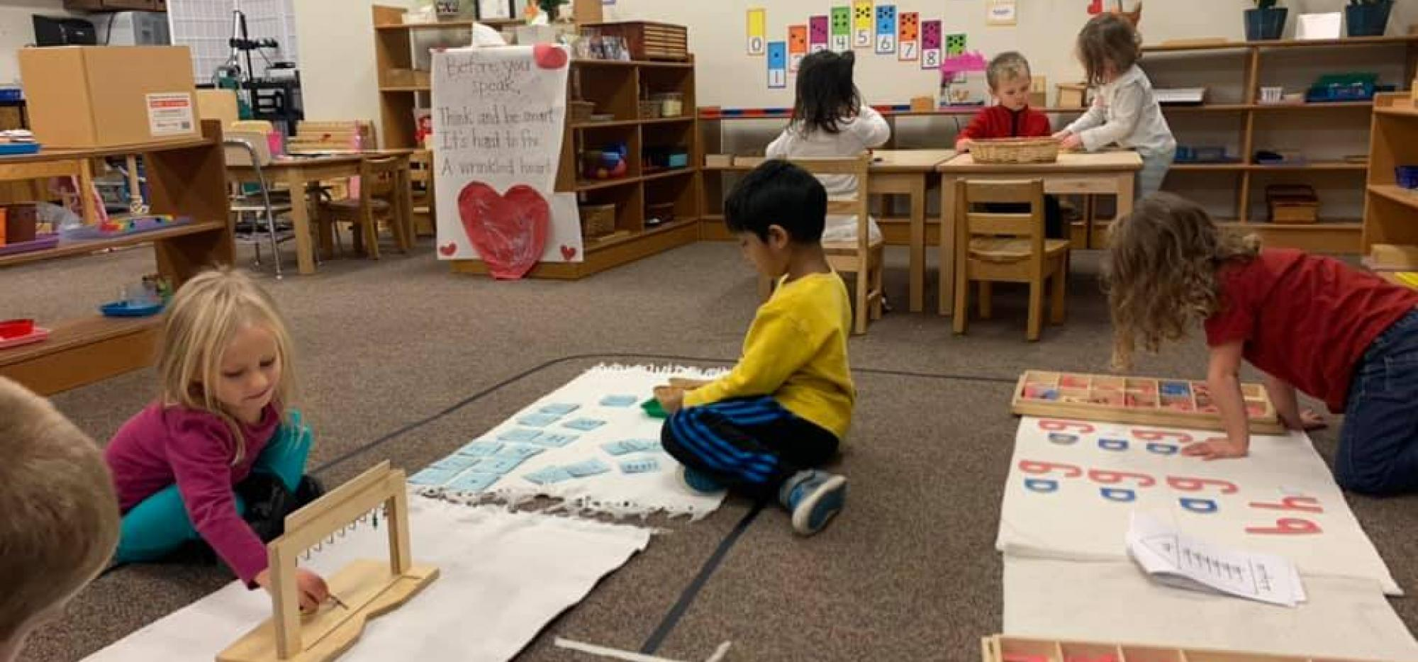 students with montessori materials